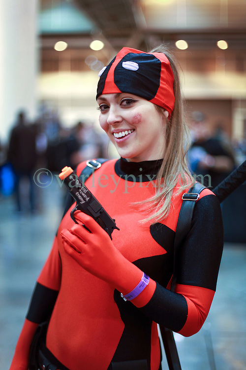 10 January 2015. New Orleans, Louisiana. <br /> Tracy Rodgers (25 yrs) at  the Wizard World New Orleans Comic Con 2015 at the Morial Convention Center. Darth Maul wanders through the crowd.<br /> Photo; Charlie Varley/varleypix.com