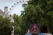 A police warning matrix blocks Queen Victoria Street outside Westminster Abbey as Westminster experiences a lockdown with extensive cordons and the closure of many streets after what police are calling a terrorist incident in which a car was crashed into security barriers outside parliament in central London, on 14th August 2018, in London, England.