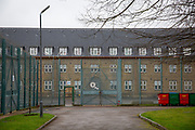 The gate and exterior fence around C wing at HMP Downview, Surrey, United Kingdom. HMP Downview is a women's closed category prison for adult sentenced women and convicted and remand female young people located on the outskirts of Banstead in Surrey, England. (Picture credit: © Andy Aitchison)