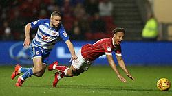 Reading's Joey van den Berg (left) and Bristol City's Bobby Reid battle for the ball