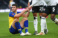 Southampton striker Charlie Austin (10) is helped to his feet by Derby County defender Max Lowe (25) and Derby County defender Fikayo Tomori (5) during the The FA Cup 3rd round match between Derby County and Southampton at the Pride Park, Derby, England on 5 January 2019.
