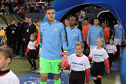 October 23, 2018 - Kharkiv, Ukraine - Goalkeeper Ederson of Manchester City FC leads a boy onto the pitch before the UEFA Champions League Group F Matchday 3 game against FC Shakhtar Donetsk at the Metalist Stadium Regional Sports Complex, Kharkiv, northeastern Ukraine, October 23, 2018. Ukrinform. (Credit Image: © Vyacheslav Madiyevskyy/Ukrinform via ZUMA Wire)