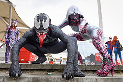 © Licensed to London News Pictures. 28/05/2017. London, UK.  (L to R) Venom and Anti-Gwenom at MCM Comic Con taking place at Excel in East London.  The three day event celebrates popular comic books, anime, games, television and movies.  Many attendees take the opportunity to dress as their favourite characters.    Photo credit : Stephen Chung/LNP
