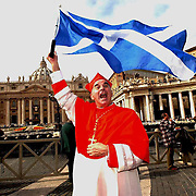 Cardinal Keith O'Brien celebrates in St Peters Square in Rome with the Saltire .<br /> Photo Robert Perry The Scotsman