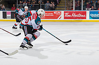 KELOWNA, CANADA - FEBRUARY 23: Kyle Crosbie #25 of the Kelowna Rockets skates with the puck against the Kamloops Blazers  on February 23, 2019 at Prospera Place in Kelowna, British Columbia, Canada.  (Photo by Marissa Baecker/Shoot the Breeze)