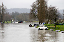Rain falls on the fast-flowing regatta course at Henley On Thames, Oxfordshire, as heavy rains in the River Thames catchment area and saturated ground causes the river to rise to within inches of bursting its banks.. April 02 2018.