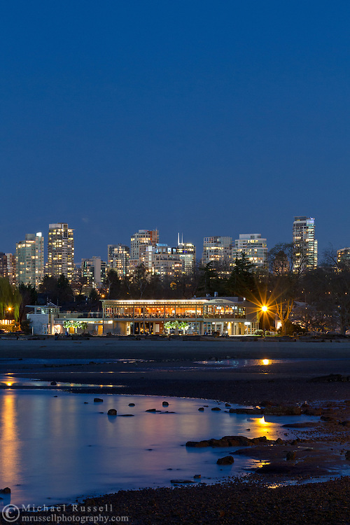 Kitsilano Beach, Vancouver apartment towers, and the Boathouse Restaurant in the early evening. Photographed from Kitsilano Beach Park in Vancouver, British Columbia, Canada