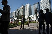 Pedestrians walk through an office district in Shenzhen, China, on Thursday, Dec. 17, 2015.