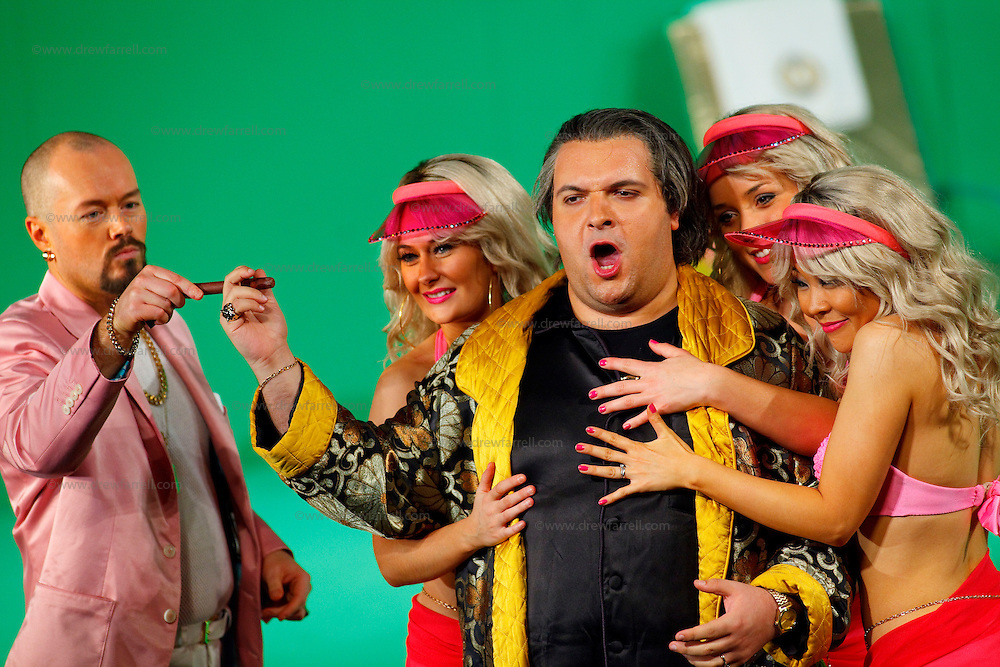 Picture shows : Tiziano Bracci as Mustafa (centre) with bunny girls and Paul Carey Jones as Haly (pink jacket)..Picture  ©  Drew Farrell Tel : 07721 -735041..A new Scottish Opera production of  Rossini's 'The Italian Girl in Algiers' opens at The Theatre Royal Glasgow on Wednesday 21st October 2009..(Soap) opera as you've never seen it before..Tonight on Algiers.....Colin McColl's cheeky take on Rossini's comic opera is a riot of bunny girls, beach balls, and small screen heroes with big screen egos. Set in a TV studio during the filming of popular Latino soap, Algiers, the show pits Rossini's typically playful and lyrical music against the shoreline shenanigans of cast and crew. You'd think the scandal would be confined to the outrageous storylines, but there's as much action off set as there is on.....Italian bass Tiziano Bracci makes his UK debut in the role of Mustafa. Scottish mezzo-soprano Karen Cargill, who the Guardian called a 'bright star' for her performance as Rosina in Scottish Opera's 2007 production of The Barber of Seville, sings Isabella..Cast .Mustafa...Tiziano Bracci.Isabella..Karen Cargill.Lindoro...Thomas Walker.Elvira...Mary O'Sullivan.Zulma...Julia Riley.Haly...Paul Carey Jones.Taddeo...Adrian Powter..Conductors.Wyn Davies.Derek Clarke (Nov 14)..Director by Colin McColl.Set and Lighting Designer by Tony Rabbit.Costume Designer by Nic Smillie..New co-production with New Zealand Opera.Production supported by.The Scottish Opera Syndicate.Sung in Italian with English supertitles..Performances.Theatre Royal, Glasgow - October 21, 25,29,31..Eden Court, Inverness - November 7. .His Majesty's Theatre, Aberdeen  - November 14..Festival Theatre,Edinburgh - November 21, 25, 27 ...Note to Editors:  This image is free to be used editorially in the promotion of Scottish Opera. Without prejudice ALL other licences without prior consent will be deemed a breach of copyright under the 1988. Copyright Design and Patents Act  and will be subject to payment or
