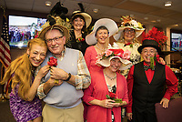 """Sporting their Kentucky Derby hats are Francine King and Bob Swartz with """"Best Use of Recycled"""" materials, Heidi Squires with """"Best of Show"""", Barb Zeckhausen with """"Most Colorful"""", Susan Branche with """"Best Use of Feathers"""", Joan Frates with """"Prettiest"""" and Larry Frates with """"Best of Show""""  at the Beane Conference Center Saturday evening put on by the Unitarian Universalist Society of Laconia.  (Karen Bobotas/for the Laconia Daily Sun)"""