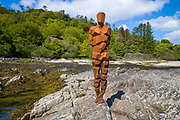 Antony Gormley sculpture GRIP of an abstract human form looking out over Saddell Bay, Kilbrannan Sound to Arran, in Kintyre, Scotland