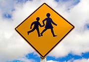 Road traffic sign warning of children crossing, North Island, New Zealand