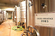 In the Chapoutier winery. Stainless steel fermentation tanks, one with Crozes Hermitage 2003 red Meysonniers Bio (organically grown vines)  Domaine M Chapoutier, Tain l'Hermitage, Drome Drôme, France Europe