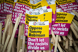 "© Licensed to London News Pictures. 14/07/2018. London, UK. PICTURED: "" Oppose Tommy Robinson Stand Up to Racism "" placards . Supporters of EDL founder Tommy Robinson ( real name Stephen Yaxley-Lennon ) and US President Donald Trump and anti fascists hold demonstrations and rallies in support and opposed to US President Donald Trump and jailed EDL founder Tommy Robinson . Trump is currently in Scotland and Robinson is in HMP Hull . Photo credit: Joel Goodman/LNP"