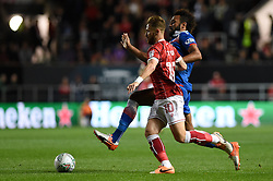 Bristol City's Matt Taylor (left) and Stoke City's Eric Maxim Choupo-Moting battle for the ball during the Carabao Cup, third round match at Ashton Gate Stadium, Bristol.