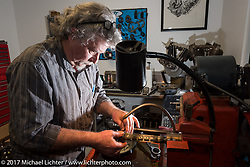 "Expert mechanic Berry Wardlaw of Accurate Engineering in Douthan, AL lived and worked in Billy Lane's shop to help build and prep motors (honing parts in this photo) for the big ""Sons of Speed"" boardtrack style race at New Smyrna Speedway during Daytona Bike Week. Daytona Beach, FL. USA. Monday March 13, 2017. Photography ©2017 Michael Lichter."