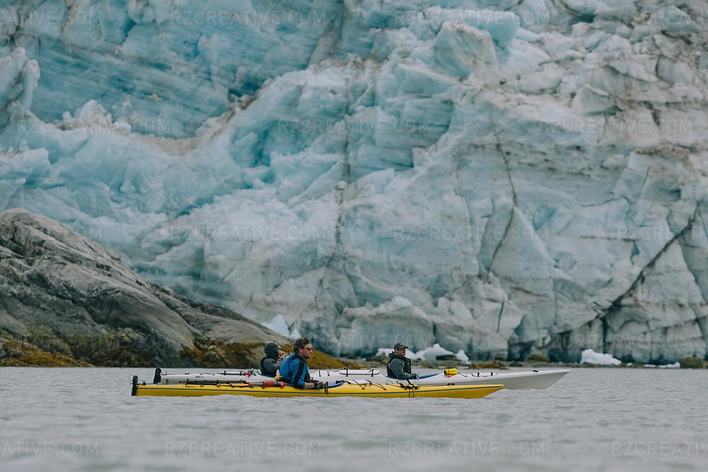 Kayakers paddling near Lamplugh Glacier in the West Arm of southeast Alaska's Glacier Bay National Park. Photo © Robert Zaleski / rzcreative.com
