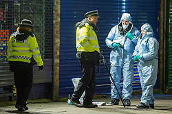 © Licensed to London News Pictures. 05/02/2020. London, UK. Police officers and forensic investigators gather evidence after the Metropolitan Police Service was called to Kingsley Rd in Hounslow at 19:23GMT on Tuesday 4th Feb to reports of a fight. A 19-year-old man then self-presented at a hospital with stab injuries. One person has been arrested. Photo credit: Peter Manning/LNP