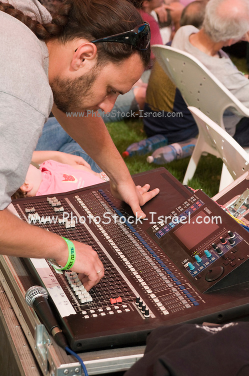 Sound technician at his station during a music performance