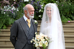 Lady Gabriella Windsor with her father Prince Michael of Kent for her wedding to Thomas Kingston at St George's Chapel in Windsor Castle.