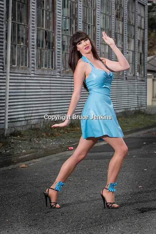 Loran Hosegood modelling blue latex dress made by Eliza-May Tolhurst, photography by Bruce Jenkins