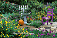 63821-12517 Fall Garden Display - Purple chair, pumpkin, bird bath & fence in flower bed  Marion Co.  IL