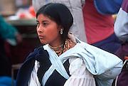 ECUADOR, MARKETS Otavalo girl vendor at Otavalo market