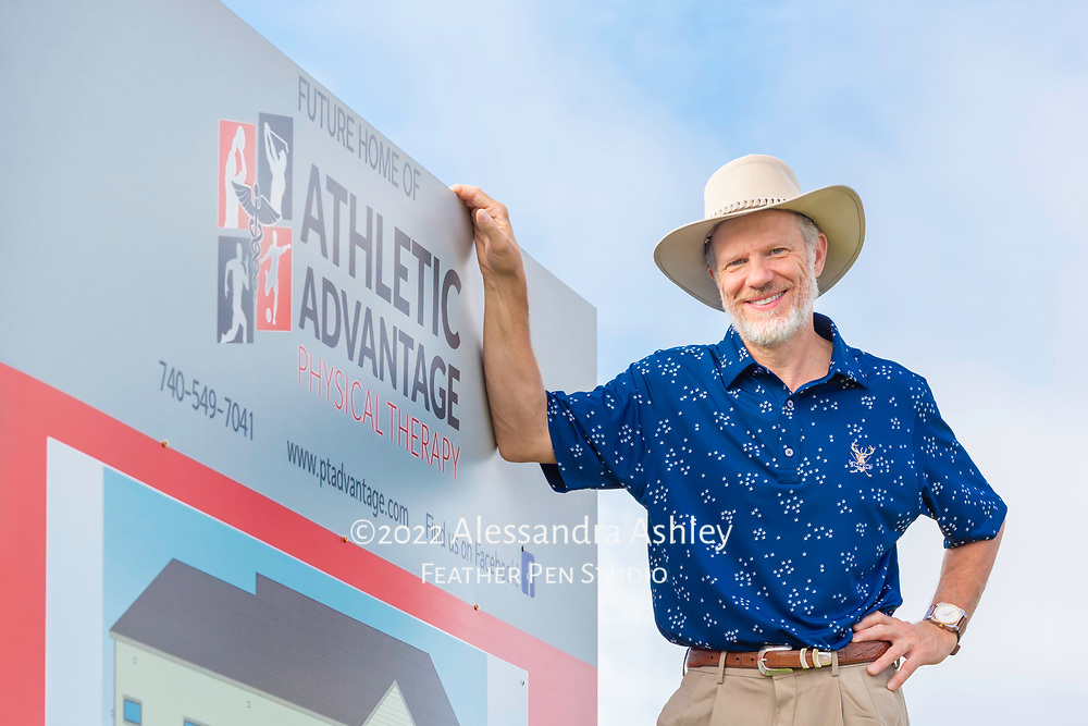 Mark Read, owner of Athletic Advantage, Inc., with preview sign at future site of new physical therapy and wellness center in Lewis Center, Ohio.