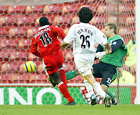 7/11/2004 - FA Barclayship Premiership - Middlesbrough v Bolton Wanderers - The Riverside Stadium<br />Middlesbrough's Jimmy Floyd Hasselbaink is brought down by Bolton Wanderers' goalkeeper jussi Jaaskelainen just outside the penalty area and is receives a red card for the challenge<br />Photo:Jed Leicester/Back Page Images