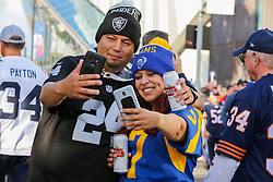 © Licensed to London News Pictures. 06/10/2019. London, UK. American Football fans take a selfie as tens of thousands of fans arrive for the NFL (The National Football League) London Games when Oakland Raiders faces Chicago Bears in the first of the two games to be played at the new Tottenham Hotspur Stadium. Photo credit: Dinendra Haria/LNP