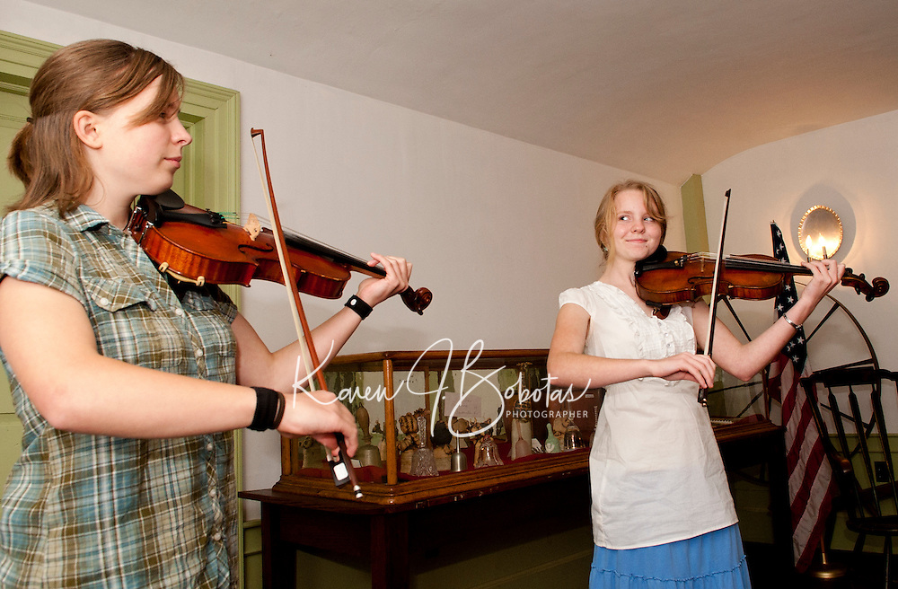 Fiona Shea and Audrey Budington play a collection of Celtic folk music at the Lane Tavern following the Sanbornton Historical Society's annual meeting and potluck dinner Thursday evening.  (Karen Bobotas/for the Laconia Daily Sun)