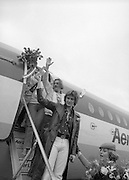 Johnny Logan on his return at Dublin Airport from Holland where he won the Eurovision Song Contest for Ireland with his entry What's Another Year..1980-04-21.21st April 1980.21-04-1980.04-21-80..Photographed at Dublin Airport..Johnny Logan (at front) holding up the Eurovision Song Contest trophy. Behind him is Shay Healy, composer of the winning song.