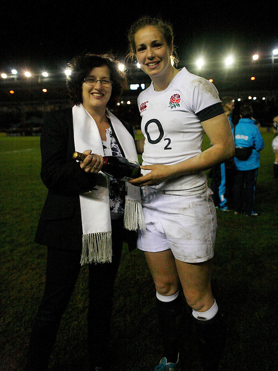 Emily Scarratt receiving Player of the Match Award from Deborah Griffin. England Women v Wales Women at Twickenham Stoop, Twickenham, England on 7th March 2014 ko 1930