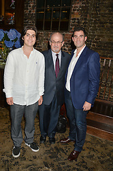 Left to right, MILAN RUSHDIE, SIR SALMAN RUSHDIE and ZAFAR RUSHDIE at a party to celebrate the engagement of Natalie Coyle and Zafar Rushdie held at Library, St.Martin's Lane, London on 6th September 2014.