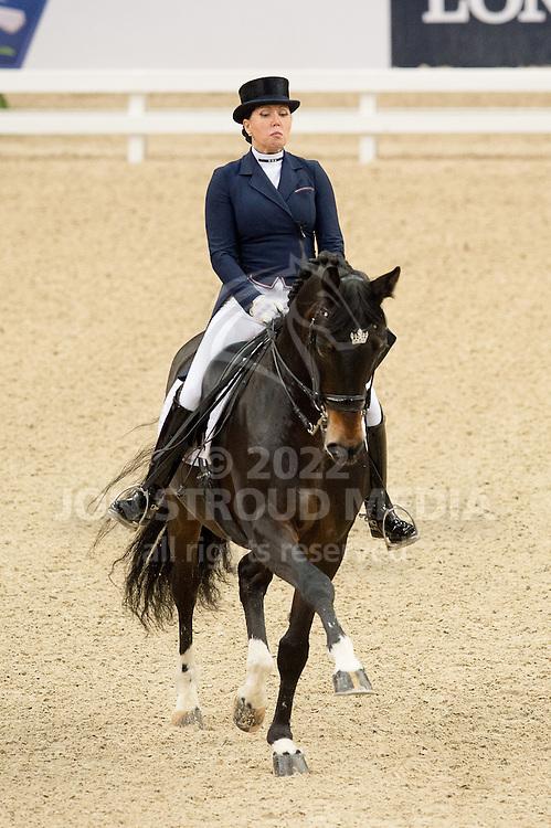 Inessa Merkulova (RUS) & Mister X - Grand Prix - Reem Acra FEI World Cup Final - Scandinavium Arena, Gothenburg, Sweden - 25 Mar 2015