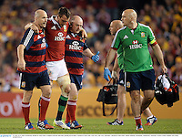 29 June 2013; Sam Warburton, British & Irish Lions, is helped from the field after picking up an injury. British & Irish Lions Tour 2013, 2nd Test, Australia v British & Irish Lions. Ethiad Stadium, Docklands, Melbourne, Australia. Picture credit: Stephen McCarthy / SPORTSFILE