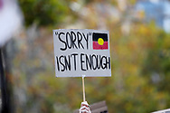 A protester holds up a sign during the protest on 06 June, 2020 in Melbourne, Australia. This event was organised to rally against aboriginal deaths in custody in Australia as well as in unity with protests across the United States following the killing of an unarmed black man George Floyd at the hands of a police officer in Minneapolis, Minnesota. (Photo by Brett Keating/ Speed Media)