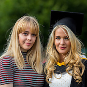 """23.08.2016        <br /> Over 300 students graduated from the Faculty of Arts, Humanities and Social Science at the University of Limerick today. <br /> <br /> Attending the conferring ceremony were Rheana Byrnes with her sister, Ciara Jayne Byrnes, Birdhill Co. Tipperary, who conferred with a Bachelor of Arts (Joint Honours). Picture: Alan Place.<br /> <br /> <br /> <br /> <br /> UL Graduates Employability remains consistently high as they are 14% more likely to be employed after Graduation than any other Irish University Graduate<br /> Each year, the Careers Service collects information about the 'First Destinations' of UL graduates. During the April/May period following graduation, we survey those who have completed full-time undergraduate and postgraduate courses for details on their current status. This current survey was conducted nine months after graduation and focuses on the employment and further study patterns of the graduates of 2015. A total of 2,933 graduates were surveyed and a response rate of 87% was achieved. <br /> As the University of Limerick commences four days of conferring ceremonies which will see 2568 students graduate, including 50 PhD graduates, UL President, Professor Don Barry highlighted the continued demand for UL graduates by employers; """"Traditionally UL's Graduate Employment figures trend well above the national average. Despite the challenging environment, UL's graduate employment rate for 2015 primary degree-holders is now 14% higher than the HEA's most recently-available national average figure which is 58% for 2014"""". The survey of UL's 2015 graduates showed that 92% are either employed or pursuing further study."""" Picture: Alan Place"""