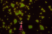 Karen Chila-Ling Ho as Violetta, surrounded by spectacular light projections, in Verdi'a La Traviata in the Philharmonia Orchestra's production at the Rose Theater at Jazz at Lincoln Center.