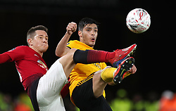 Manchester United's Ander Herrera (left) and Wolverhampton Wanderers' Raul Jimenez battle for the ball during the FA Cup quarter final match at Molineux, Wolverhampton.