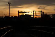 Sunset on a bridge over Regents Canal looking across railway tracks towards The Shard in East London, England, United Kingdom.