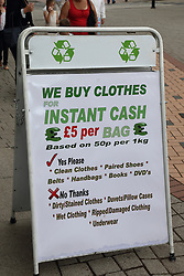 Sign advertising the purchase of clothing