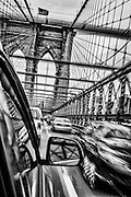 Crossing the Brooklyn Bridge from a NYC cab viewpoint.