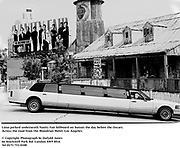 Limo parked underneath Vanity Fair billboard on Sunset the day before the Oscars. Across the road from the Mondrian Hotel. Los Angeles.<br /> <br /> © Copyright Photograph by Dafydd Jones<br /> 66 Stockwell Park Rd. London SW9 0DA<br /> Tel 0171 733 0108<br /> Mortons,  Los Angeles