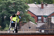 """Oldham, United Kingdom, June 21, 2021: Police appears to be collecting evidence at the site following the arrest of Palestine Action activists after they scaled the roof of """"Cairo House"""" in Oldham on Monday, June 21, 2021. This is the ongoing protest forms of the human rights activists group in Britain targeting an Israeli owned weapons manufacturer Elbit Systems. Activists argue that arms being manufactured in the facility are being used in indiscriminate attacks against the Gaza Strip. (VX Photo/ Vudi Xhymshiti)"""