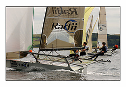 The 2004 Skiff Nationals at Largs held by the SSI.<br /> Andy Richards, Andy Fairlie and Dave Richards onboard Radii.<br /> <br /> Marc Turner / PFM Pictures
