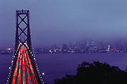 Oakland-San Francisco Bay Bridge photographed from the top of the tunnel that goes through Yerba Buena. City lights of San Francisco seen on the right.
