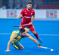 BHUBANESWAR, INDIA -  Adam Dixon (Eng)  with Trent Mitton (Aus) , England v Australia for the bronze medal during the Odisha World Cup Hockey for men  in the Kalinga Stadion.   COPYRIGHT KOEN SUYK