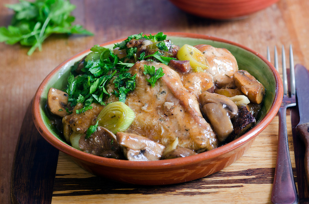 Marinated chicken and roasted mushrooms in rich red wine and brandy sauce