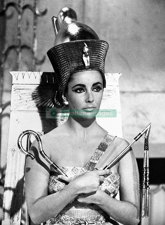 27TH FEBRUARY : On this day in 1932 actress Elizabeth Taylor was born. Elizabeth Taylor in her starring role as Cleopatra, Queen of Egypt. Also starring in the film are Richard Burton and Rex Harrison amoungst a host of other top actors and actresses.  26/06/02 : Elizabeth Taylor in her starring role as Cleopatra, Queen of Egypt, where she starred alongside Richard Burton. During the making of the film, a wrist watch was given to Richard Burton by Elizabeth Taylor and today fetched  9,635 at hammer at Christie's in London. Inscribed in Welsh on the reverse W I N DY GARU DI (I Love You), the 18ct gold Patek Philippe automatic wristwatch was one of the first gifts exchanged between the two Hollywood stars. The watch was offered at Christie s by one of Richard Burton s personal assistants, who was given the watch by the Hollywood star. The buyer is said to be from Cwmbran in Wales and a huge fan of both Taylor and Burton and had taken the day off work especially in order to travel to London to attempt to buy the watch.